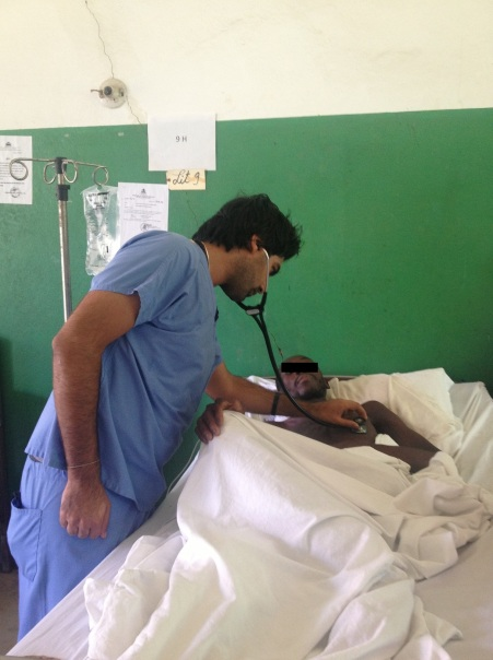 Dr Varun Verma with a patient on the inpatient ward