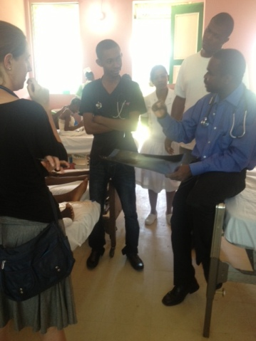 Dr. Pierre, Haitian ZL Leader teaching rounds in Hinche, Haiti with our fellow Robin Tittle.